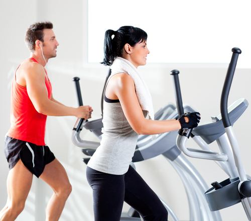Man and woman on a cross-trainer